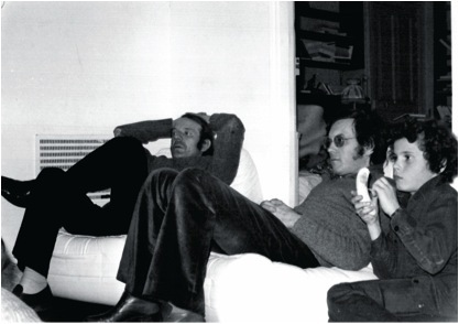 Gilles Deleuze and Félix Guattari watching television with the latter's son Bruno in Guattari's apartment, Paris, 1969.